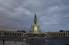 The Sanctuary of Fatima at the sunset, Fatima, Portugal. Fatima, Portugal - July 2014: The Sanctuary of Fatima, which is also referred to as the Basilica of Our stock image