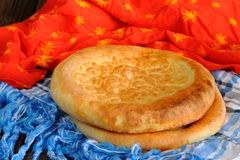 Fatir, uzbek flatbread on blue arab scarf and red cloth Royalty Free Stock Images