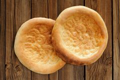 Fatir, uzbek flatbread on old wooden background top view Royalty Free Stock Photography