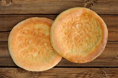 Fatir, uzbek flatbread on old wooden background top view Stock Photos