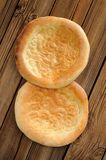Fatir, uzbek flatbread on old wooden background top view Royalty Free Stock Image