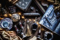 Antique & Oriental flatlay. Fatlay with antique oriental decor accessories and Quran Royalty Free Stock Photo