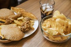 Fattening and unhealthy fast food on the table royalty free stock photo
