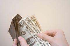 Fattig kvinnlig hållplånbok med lite pengar royaltyfria foton