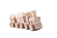 Fatto di legno, treni del giocattolo di configurazione. Immagine Stock