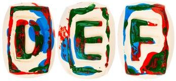 Fatto a mano variopinto delle lettere bianche dell'argilla Fotografia Stock