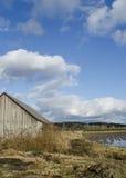 Fattoria con le nuvole fotografia stock