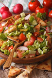 Fattoush fresh salad close-up on a plate. vertical Royalty Free Stock Images
