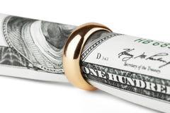 Fattura del dollaro in un anello Fotografie Stock Libere da Diritti