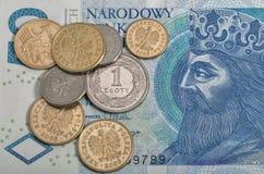 Fattura polacca e monete di zloty macro Immagine Stock