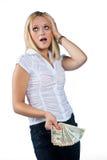 Fatture del dollaro della holding della donna in sua mano Fotografia Stock