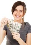 Fatture del dollaro della holding della giovane donna Fotografia Stock