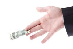 Fatture del dollaro della holding della mano dell'uomo Immagini Stock