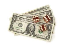 Fatture del dollaro e dei dadi Fotografia Stock