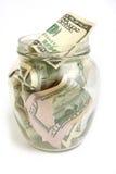 Fatture del dollaro in vaso di vetro Immagine Stock Libera da Diritti