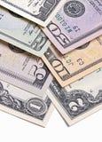 Fatture di soldi americane del dollaro degli Stati Uniti su fondo bianco Fotografia Stock