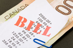 Fatture e dollari canadesi Fotografie Stock Libere da Diritti