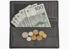 Fatture polacche e monete di zloty in portafoglio isolato su bianco Immagine Stock Libera da Diritti