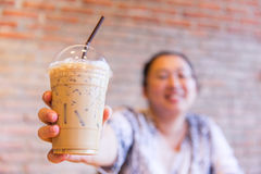 Fatty asian women smile with ice cool milk coffee drink stock photo
