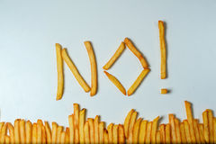 Fatty french fries on white background Royalty Free Stock Photos