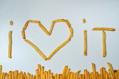 Fatty french fries on white background. French fries forming words I love it on a white background Stock Photos