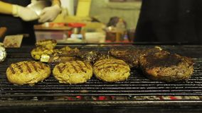 Fatty grilled meat, barbecue. Unhealthy food at street food festival. Obesity. Stock footage stock video