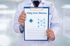 Fatty Liver Disease. Portrait of a doctor writing a prescription royalty free stock images