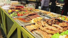 Fatty meat displayed at street shop. Unhealthy food, cholesterol, overweight. Stock footage stock video