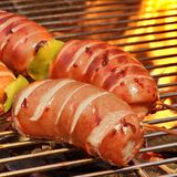 Fatty Sausages On The Hot Barbecue Flaming Charcoal Grill Royalty Free Stock Photography