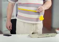 Fatty shows how measure his stomach Stock Photography