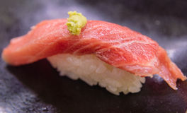 Fatty tuna belly nigiri sushi. Extreme close up of fatty tuna belly nigiri sushi Stock Photo