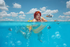 Fatty woman and piranhas Royalty Free Stock Images