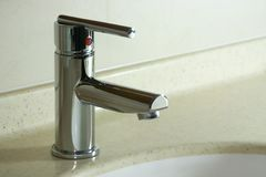 Faucet. A simple faucet in a hotel bathroom Royalty Free Stock Photos