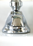Faucet. A close-up of a silver dripping facuet Royalty Free Stock Photo