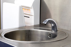 Faucet in the bathroom. A faucet in the bathroom Royalty Free Stock Images