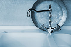 Faucet of blue color Royalty Free Stock Images