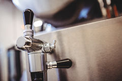 Faucet on bottling plant in brewery Royalty Free Stock Photography