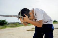 Faucet boy Stock Photography