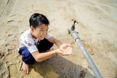 Faucet boy Stock Photo