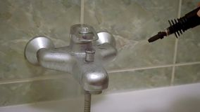 Faucet cleaning with steam stock video