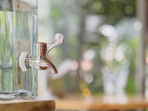 The faucet with the clear flask. Close up the faucet with the clear flask Royalty Free Stock Image