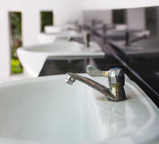 Faucet close up at public toilets Stock Image