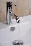 Faucet com água Foto de Stock