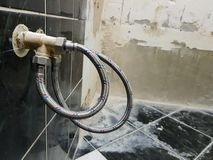 Faucet and flexible connection for water supply - tap water royalty free stock image