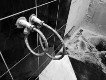 Faucet and flexible connection for water supply - tap water royalty free stock photography