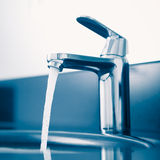 Faucet with flowing water Royalty Free Stock Photography