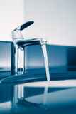 Faucet with flowing water Stock Photo