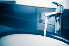Faucet with flowing water Stock Photos