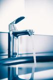 Faucet with flowing water Stock Image