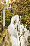 Faucet with frozen water Stock Photo